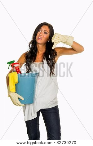 a young woman is annoyed that she has to make the house cleaning.