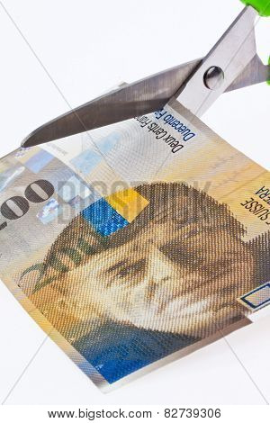 swiss franc banknotes. currency of switzerland with scissors