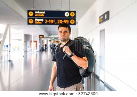 Young Tourist Man In Airport. Travel Concept