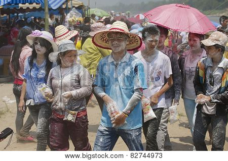 People celebrate Lao New Year in Luang Prabang, Laos.