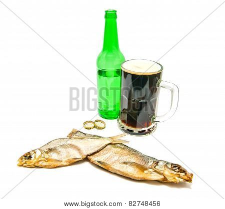 Salted Fishes And Glass Of Beer Closeup