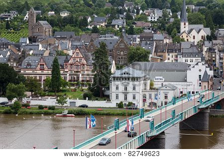 Cityscape Of Traben-trarbach With People And Cars Crossing The Bridge Over River Moselle