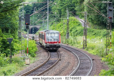 Train Driving Through Woods Near River Moselle In Germany