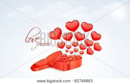 3D red hearts coming out from a heart shaped box on cloudy background for Happy Valentine's Day celebrations.