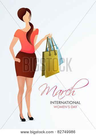 Young fashionable girl holding shopping bags on grey background for International Women's Day celebration.