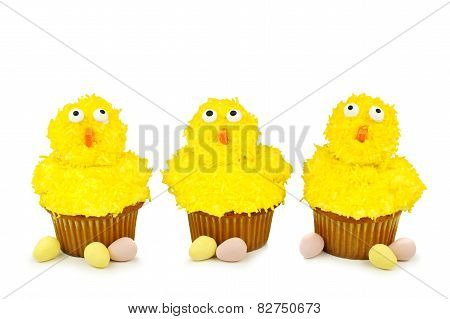 Easter chick cupcakes over white