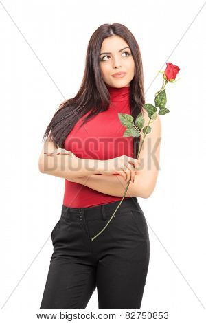 Beautiful pensive woman holding a red rose isolated on white background