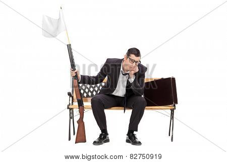Businessman holding rifle with white flag on it isolated on white background