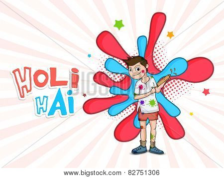 Cute little boy playing with color gun on occasion of Indian festival, Happy Holy celebration.