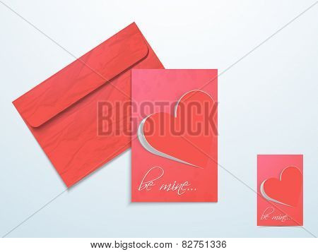 Glossy love greeting card with red flip heart, text Be Mine and envelope.
