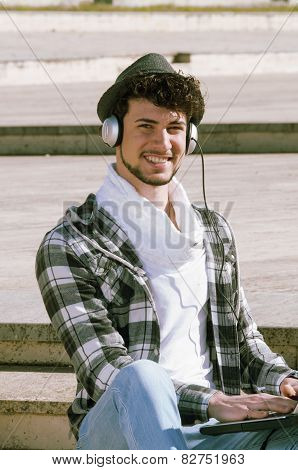 Boy Whit Headphones Smiling