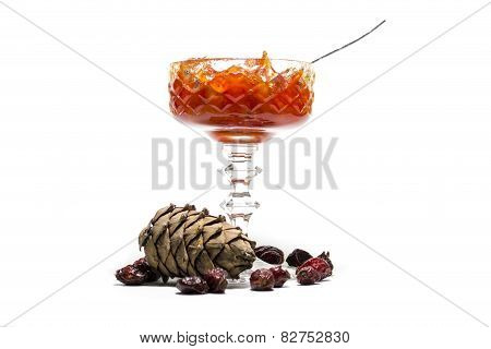 jam in a vase and pine cones