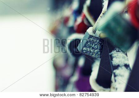 Love padlocks, closeup. Winter season