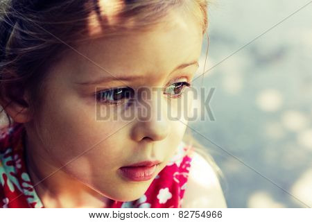 Little girl in a pensive mood