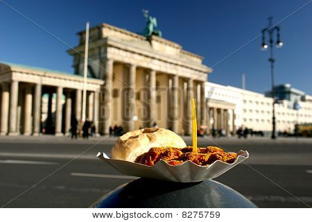 Currywurst and Brandenburg Gate in Berlin.