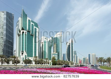 DOHA, Qatar - February 11, 2015: Towers on Doha Corniche, including the Islamic Ministry, Salam Tower, Electricity ministry and Doha Bank