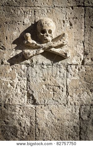 Skull and Crossbones carved in the rock