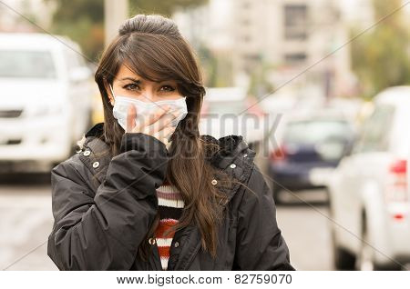 young girl walking wearing a mask in the city street concept of  pollution