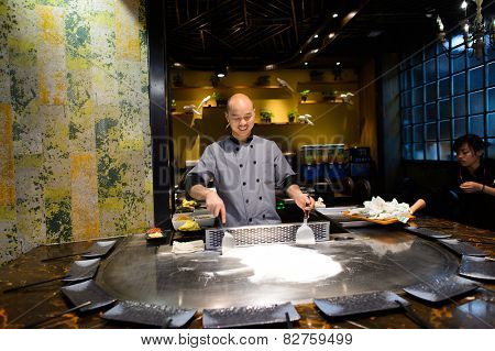 SHENZHEN, CHINA - FEBRUARY 04, 2015: cooking master in asian restaurant. ShenZhen is regarded as one of the most successful Special Economic Zones.