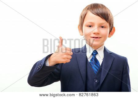 Business child in suit and tie showing his thumb up
