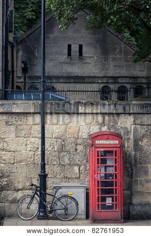Red Phone Booth And Bicyle