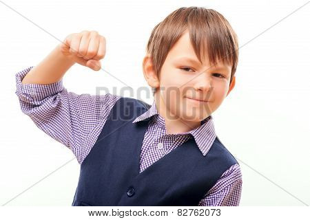 Cute child in suit showing the fist