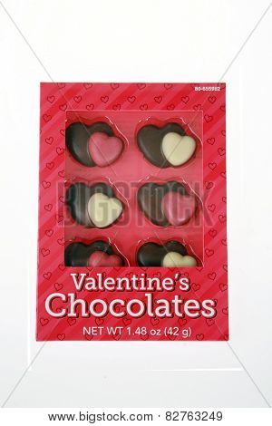 Lake Forest CA - February 13, 2015: Box of chocolate hearts for Valentines day gift to one you love. isolated on white with room for your text