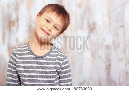 Portrait of a cute emotional little boy in bed