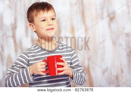 Portrait of little boy with a cup