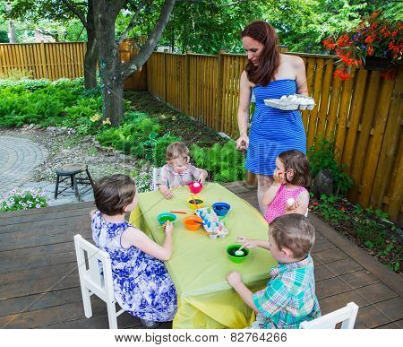 Mother Hands Out New Easter Eggs To Paint