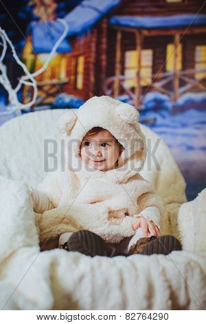 Cute funny baby girl is in the suit of bear-cub
