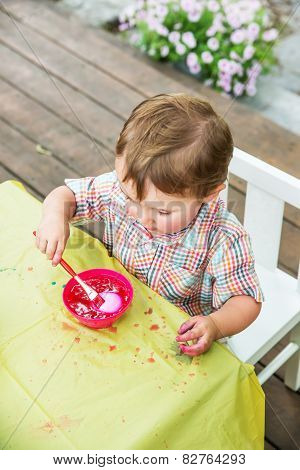 Little Boy Dyes His Easter Egg Pink