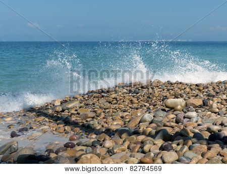 Water breaking on rock shore