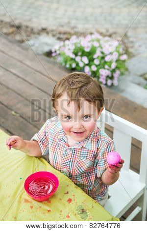 Happy Little Boy Poses With His Dyed Pink Easter Egg