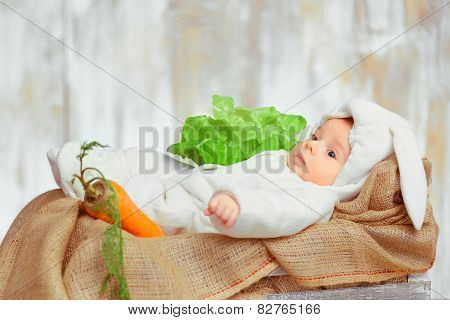 Adorable little baby in a funny bunny bodysuit