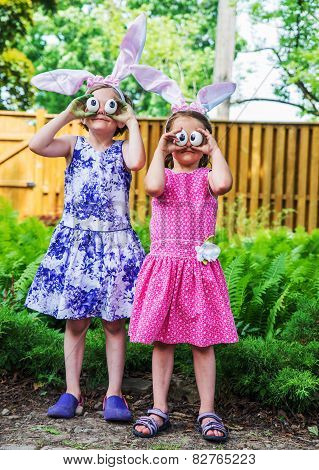 Girls Wearing Bunny Ears And Silly Egg Eyes