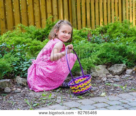 Girl Smiling During An Easter Egg Hunt