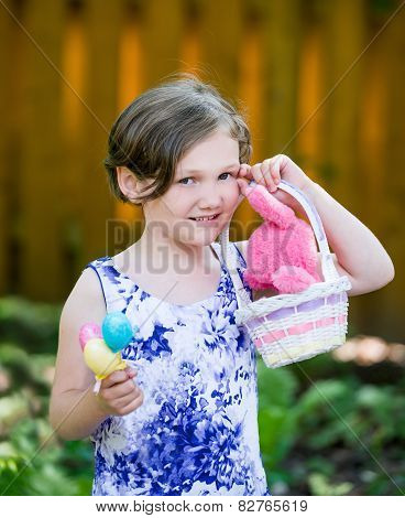Girl Holding Eggs And An Easter Basket With Bunny