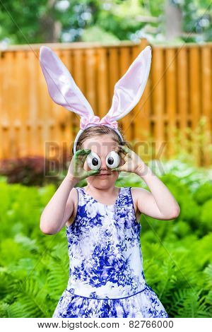 Girl Wearing Bunny Ears And Silly Egg Eyes