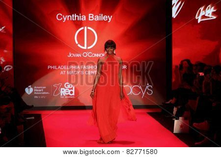 NEW YORK-FEB 12: Cynthia Bailey wears Jovan O'Connor at Go Red for Women-The Heart Truth Red Dress Collection during Mercedes-Benz Fashion Week at Lincoln Center on February 12, 2014 in New York City.