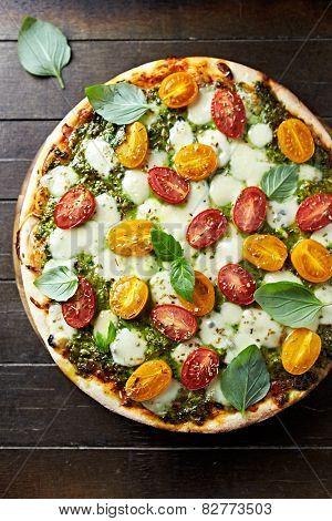 Cherry tomato and mozzarella pizza with basil pesto