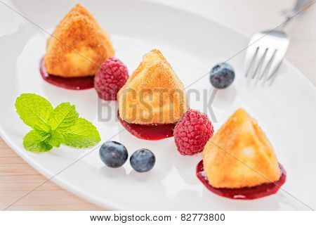 Fried Camembert Cheese With Raspberry Coulis And Fresh Berry