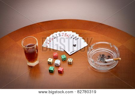 Alcohol, cards, dice and cigarette