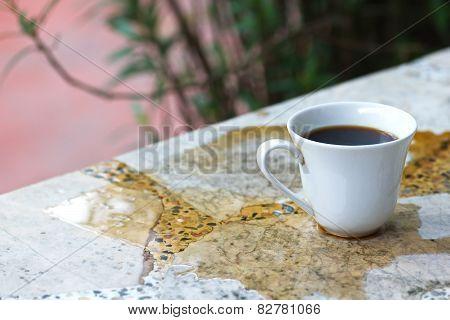 cafa espresso pour on old table .