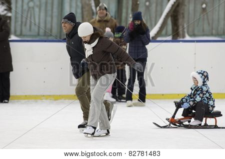 Happy Family With A Sledge