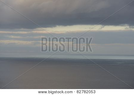 Blurred Sunshine Reflections In Ocean And Clouds Over Canary Islands.