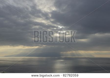 Sunrays Through The Clouds Over Gomera Island.