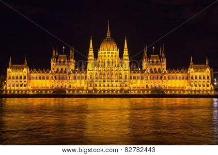 Budapest Parliament Building Illuminated During Evening, With Reflections In Danube River, Hungary,