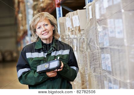 female worker in warehouse working with bar code scanner