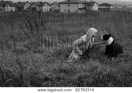 woman sitting with staffordshire terrier